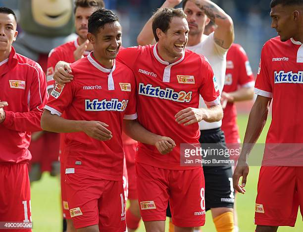 Kenny Prince Redondo and Stephan Fuerstner of 1 FC Union Berlin laugh during the game between Union Berlin and MSV Duisburg on september 26 2015 in...