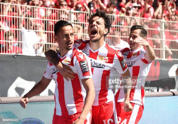 Kenny Prince Redondo, Philipp Hosiner and Steven Skrzybski of 1 FC Union Berlin celebrate after scoring the 1:1 during the match between Union Berlin...
