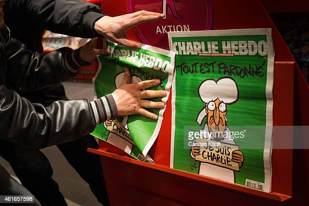 Kenny Rebenstock and Nico Hirte grab the only two issues of the French satirical magazine Charlie Hebdo, the first published after the recent Paris...