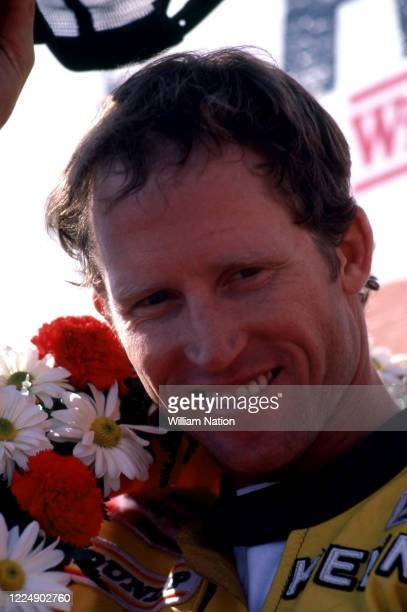 Kenny Roberts of the United States and rider of the Yamaha 500cc, celebrates after winning the 1982 Champion Spark Plug 200 race on July 11, 1982 at...
