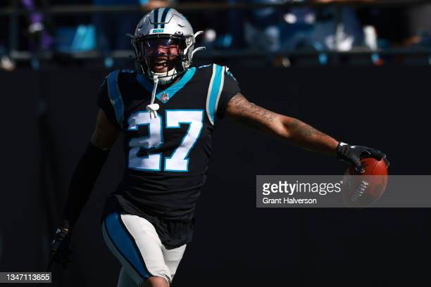 Kenny Robinson of the Carolina Panthers celebrates a touchdown scored after a blocked punt return during the third quarter against the Minnesota...