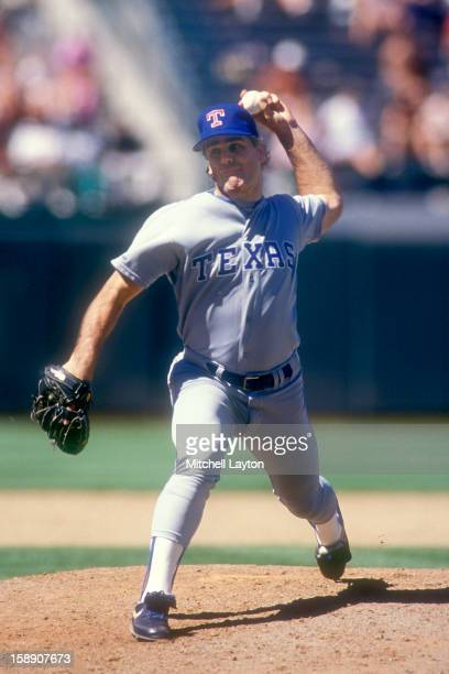 Kenny Rodgers of the Texas Rangers pitches during a baseball game against the Oakland Athletics on June 12 1990 at County Stadium in Oakland...