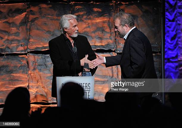 Kenny Rogers and Don Schlitz speak onstage at the Songwriters Hall of Fame 43rd Annual induction and awards at The New York Marriott Marquis on June...