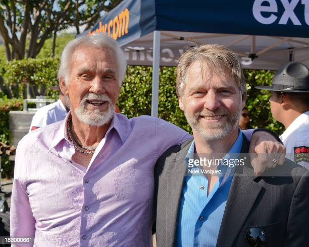 Kenny Rogers and his son Kenny Rogers Jr visit Extra at Universal Studios Hollywood on October 3 2013 in Universal City California