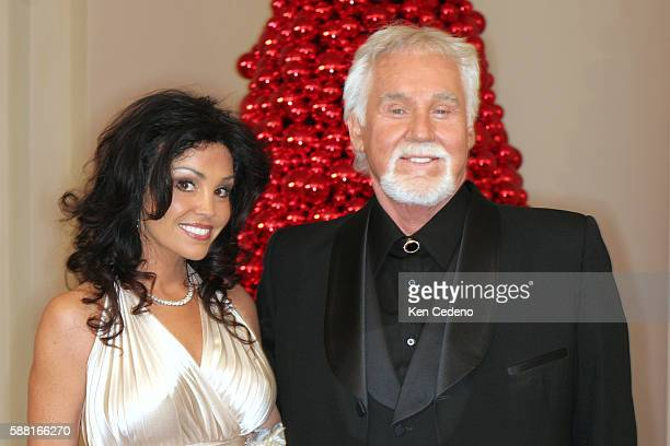 Kenny Rogers and his wife Wanda at a White House reception for the 29th annual Kennedy Center Honorees director Steven Spielberg composer Zubin Mehta...