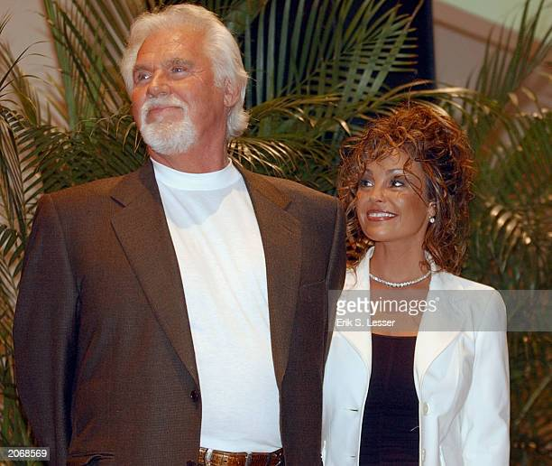 Kenny Rogers and his wife Wanda Miller watch the festivities during the retro premiere of the movie 9 to 5 for the 8th Annual Georgia Campaign for...