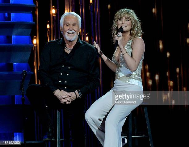 Kenny Rogers and Jennifer Nettles perform onstage during the 47th annual CMA Awards at the Bridgestone Arena on November 6 2013 in Nashville Tennessee