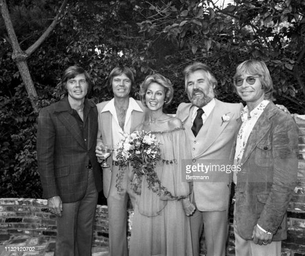 Kenny Rogers and Marianne Gordon pose for cameras after they were married at the Rogers home. The private ceremony was performed by singer John...
