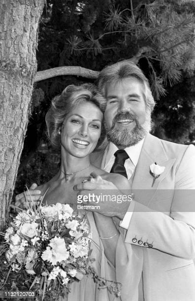Kenny Rogers and Marianne Gordon pose for cameras after they were married at the Rogers home The private ceremony was performed by singer John...