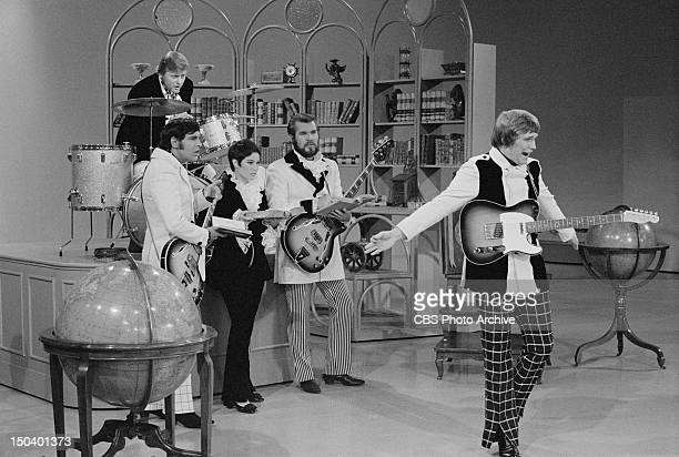 Kenny Rogers and The First Edition appear on The Smothers Brothers Comedy Hour Standing from left Mike Settle Thelma Camacho Kenny Rogers and Terry...