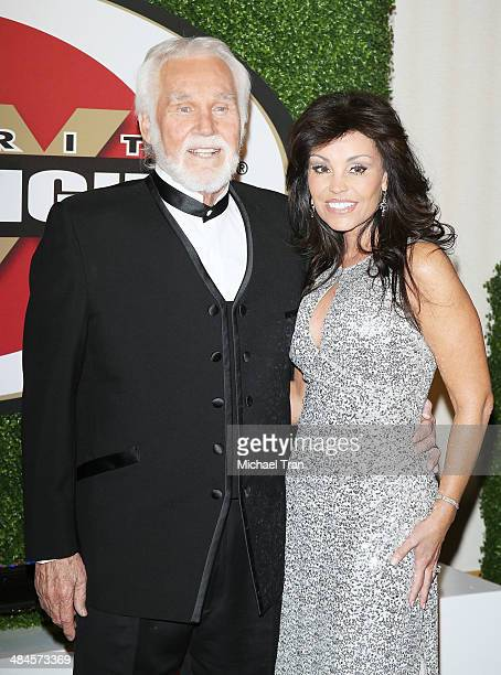Kenny Rogers and Wanda Miller arrive at the Celebrity Fight Night XX held at JW Marriott Desert Ridge Resort Spa on April 12 2014 in Phoenix Arizona