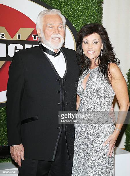 Kenny Rogers and Wanda Miller arrive at the Celebrity Fight Night XX held at JW Marriott Desert Ridge Resort & Spa on April 12, 2014 in Phoenix,...