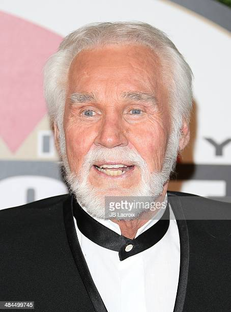 Kenny Rogers and Wanda Miller attend the Muhammad Ali's Celebrity Fight Night XX at JW Marriott Desert Ridge Resort Spa on April 12 2014 in Phoenix...