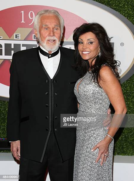 Kenny Rogers, and Wanda Miller attend the Muhammad Ali's Celebrity Fight Night XX at JW Marriott Desert Ridge Resort & Spa on April 12, 2014 in...