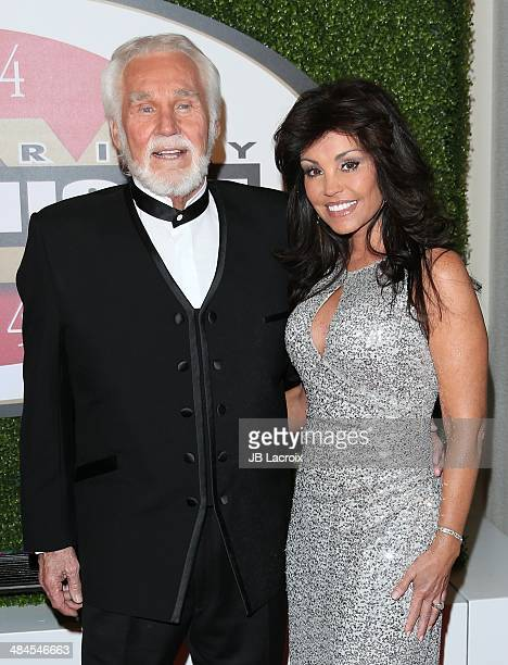 Kenny Rogers and Wanda Miller attend the Muhammad Ali's Celebrity Fight Night XX at JW Marriott Desert Ridge Resort & Spa on April 12, 2014 in...