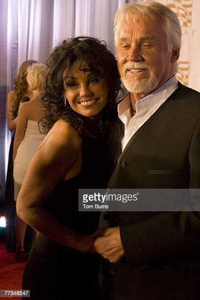 Kenny Rogers and wife Wanda Miller arrive at the Ryman Auditorium for the ASCAP 2007 Country Awards Show on October 15 2007 in Nashville Tennessee