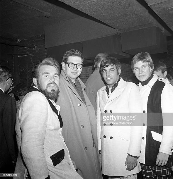 Kenny Rogers Mike Settle and Terry Williams of the rock and roll band The First Edition perform at the Bitter End night club on November 8 1967 in...