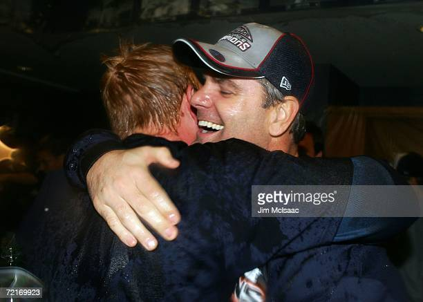 Kenny Rogers of the Detroit Tigers celebrates in the locker room with Chris Shelton after the Tigers 63 win against the Oakland Athletics during Game...
