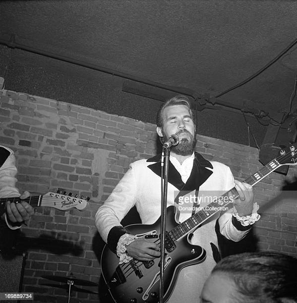 Kenny Rogers of the rock and roll band The First Edition performs at the Bitter End night club on November 8 1967 in New York New York