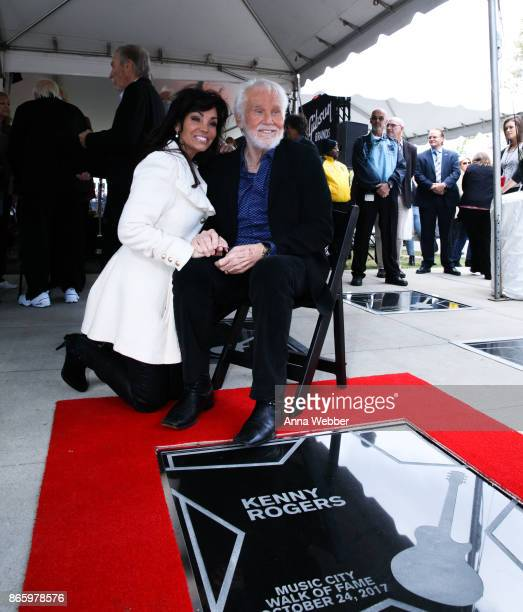 Kenny Rogers poses with wife Wanda Miller as he is inducted into the Nashville Music City Walk of Fame on October 24 2017 in Nashville Tennessee