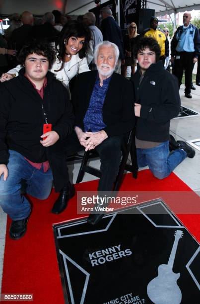 Kenny Rogers poses with wife Wanda Rogers and twin sons Justin and Jordan Rogers attend as Kenny Rogers Induction Into The Nashville Music City Walk...