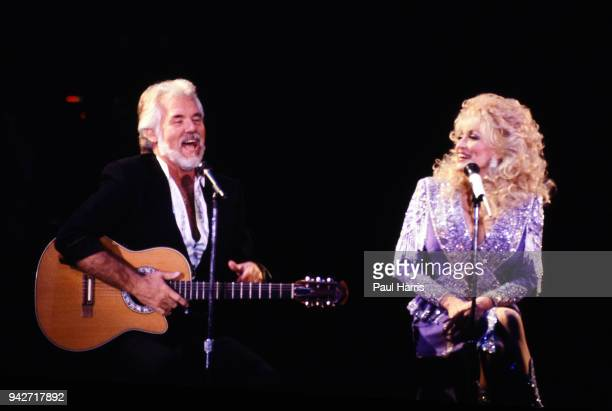 Kenny Rogers sings with Dolly Parton in a concert performance January 1990 in Los Angeles California