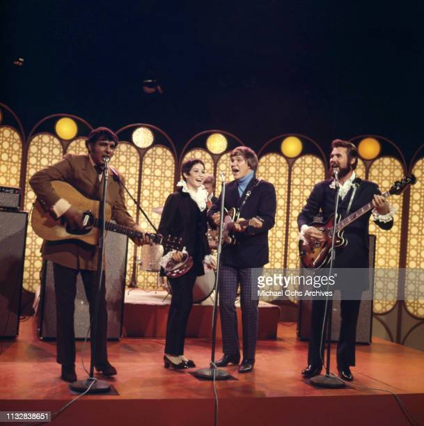 Kenny Rogers Thelma Camacho Mike Settle and Terry Williams of the band Kenny Rogers The First Edition perform on a TV show in 1967
