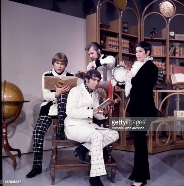 Kenny Rogers Thelma Camacho Mike Settle and Terry Williams of the band Kenny Rogers The First Edition pose for a portrait session in 1967
