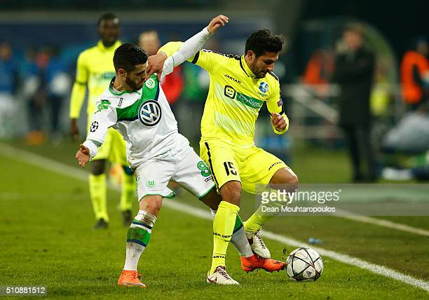 Kenny Saief of KAA Gent is challenged by Vierinha of Wolfsburg during the UEFA Champions League round of 16 first leg match between KAA Gent and VfL...
