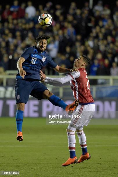 Kenny Saief of United States battles Miguel Almiron of Paraguay for a header during their game at WakeMed Soccer Park on March 27 2018 in Cary North...