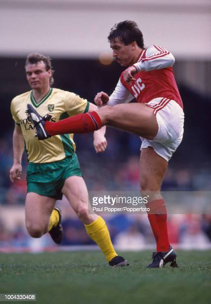 Kenny Sansom of Arsenal clears the ball under pressure from Robert Fleck of Norwich City during a Barclays League Division One match at Highbury on...