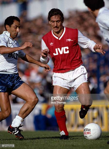 Kenny Sansom of Arsenal with Osvaldo Ardiles of Tottenham Hotspur during the Tottenham Hotspur v Arsenal Division 1 match played at White Hart Lane...