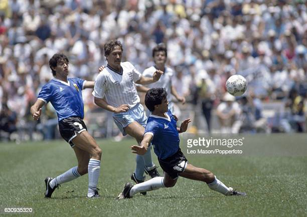 Kenny Sansom of England in action with Jorge Burruchaga and Hector Enrique of Argentina during the World Cup QuarterFinal match between England and...