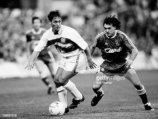Kenny Sansom of Queens Park Rangers with Ray Houghton of Liverpool during the Queens Park Rangers v Liverpool Division 1 match played at Loftus Road...
