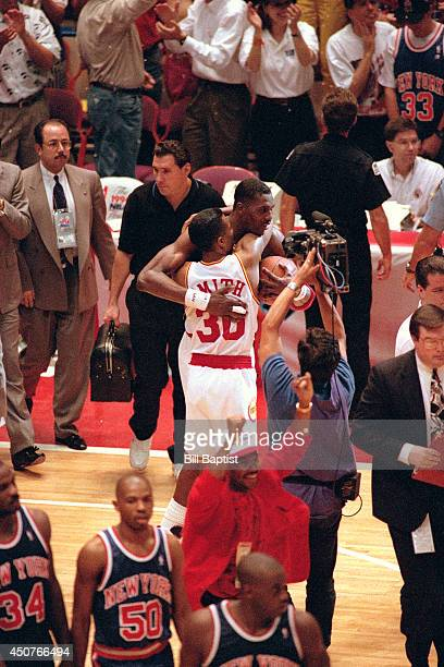 Kenny Smith and Hakeem Olajuwon of the Houston Rockets celebrate after beating the New York Knicks in Game Seven of the NBA Finals on June 22 1994 at...