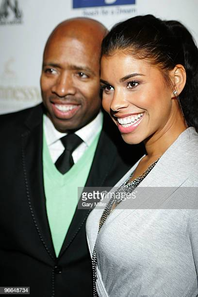 Kenny Smith and his wife Gwen Smith on the red carpet for the Kenny Smith AllStar Bash at Deux Lounge on February 12 2010 in Dallas Texas