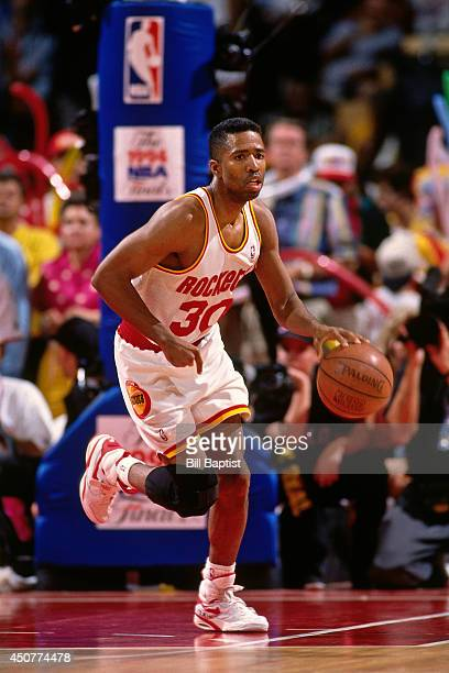 Kenny Smith of the Houston Rockets dribbles the ball up court during Game Six of the NBA Finals against the New York Knicks on June 19 1994 at The...