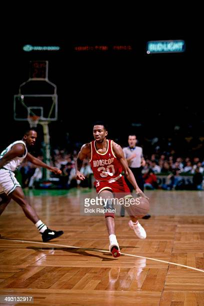 Kenny Smith of the Houston Rockets drives against the Boston Celtics during a game played circa 1994 at the Boston Garden in Boston Massachusetts...