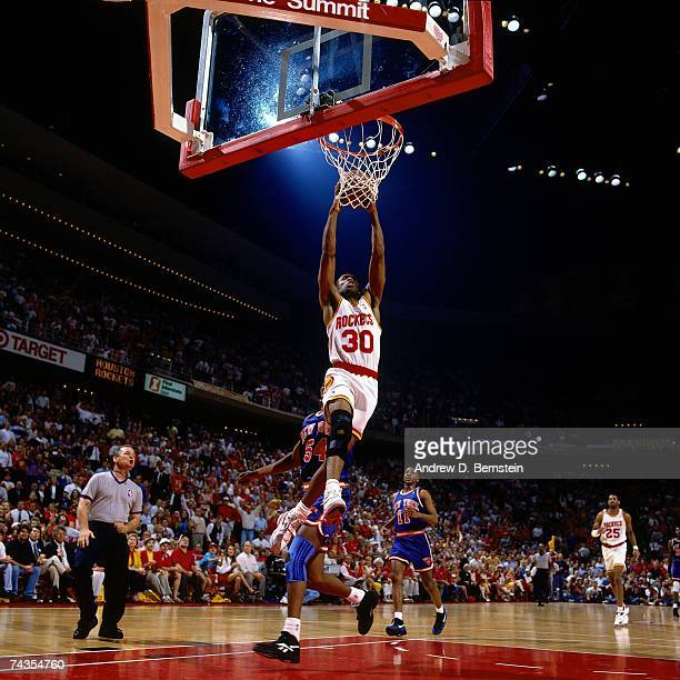 Kenny Smith of the Houston Rockets dunks against Charles Smith of the New York Knicks during Game Seven of the 1994 NBA Finals at the Summit on June...