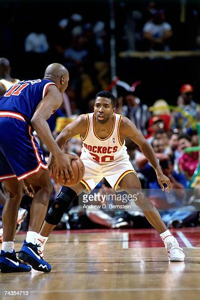 Kenny Smith of the Houston Rockets plays defense against Derek Harper of the New York Knicks during Game Six of the NBA Finals played on June 19 1994...
