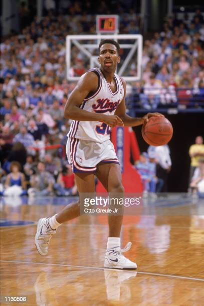 Kenny Smith of the Sacramento Kings dribbles the ball during an NBA game at Arco Arena in Sacramento California in 1988
