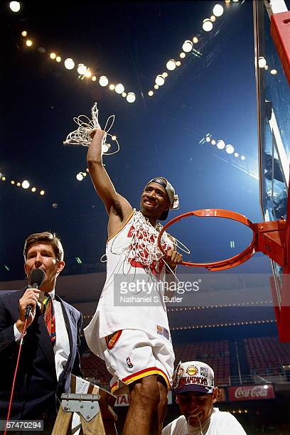 Kenny Smith waves with the net after the Houston Rockets defeated the Orlando Magic in Game four of the NBA Finals to win the NBA Championship at The...