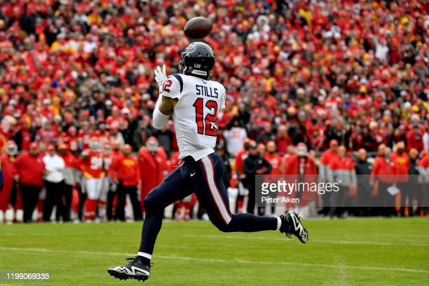 Kenny Stills of the Houston Texans catches a deep pass for a touchdown in the first quarter of the AFC Divisional playoff game against the Kansas...