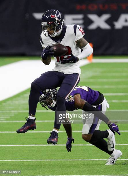 Kenny Stills of the Houston Texans catches a pass against Anthony Averett of the Baltimore Ravens during the first half at NRG Stadium on September...