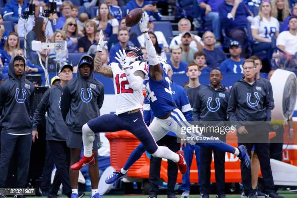 Kenny Stills of the Houston Texans catches a pass while being defended by Rock YaSin of the Indianapolis Colts during the second quarter at Lucas Oil...