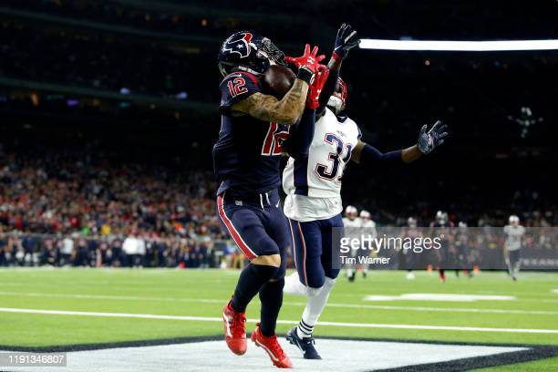 Kenny Stills of the Houston Texans catches a touchdown pass against Jonathan Jones of the New England Patriots during the third quarter in the game...
