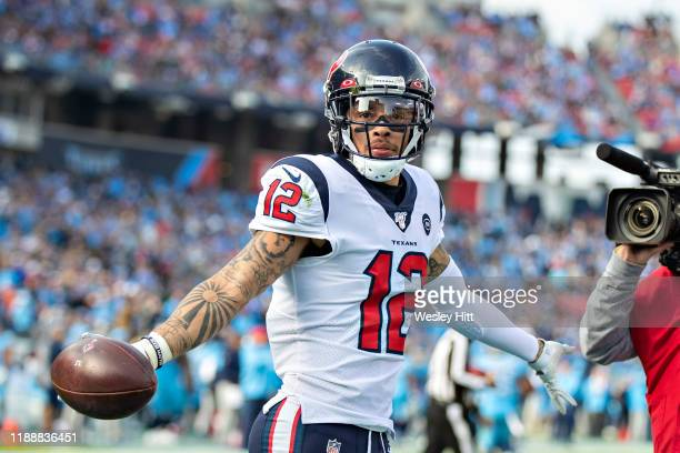 Kenny Stills of the Houston Texans celebrates after catching a pass for a touchdown in the first half of a game against the Tennessee Titans at...