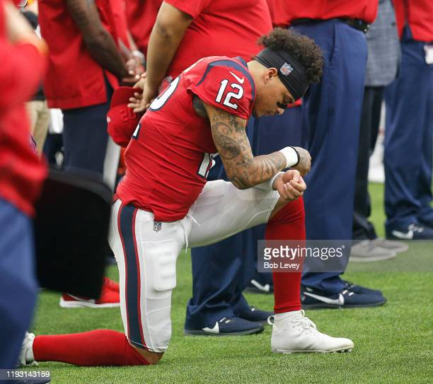 Kenny Stills of the Houston Texans kneels during the national anthem before playing the Denver Broncos at NRG Stadium on December 08, 2019 in...