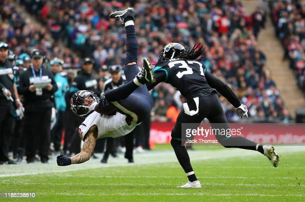 Kenny Stills of the Houston Texans makes a catch over Tre Herndon of the Jacksonville Jaguars during the NFL match between the Houston Texans...