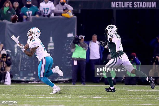 Kenny Stills of the Miami Dolphins catches a 52 yard touchdown pass against Juston Burris of the New York Jets during the second quarter of the game...